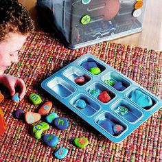 painted rocks - Collect rocks. Clean the rocks, then paint them with several coats of acrylic paint. Let dry and decorate with letters, dots, symbols, or other imaginative motifs. Protect the paint with several coats of spray varnish