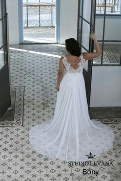 Open back lace plus size wedding gown with a see through chiffone train