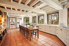 Generous farm-style kitchen -- white cabs, tile floor and isolated fridge w/built in Two Tone Kitchen Cabinets, White Cupboards, Kitchen Tile, Kitchen Flooring, Mexican Tile Kitchen, Tile Flooring, Spanish Tile Kitchen, Kitchen Decor, White Counters