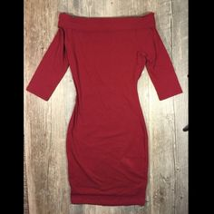 NWT Burgundy off shoulder 3/4 sleeve midi dress NWT Burgundy off the shoulder 3/4 sleeve midi dress. Foldover top. 34 inches long, should hit around knee. Cotton 5% spandex. Tag reads medium. Charlotte Russe Dresses Midi