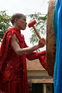laos-luang-prabang-laos-new-year-phi-mai-lao-young-monk-hits-drum-tiger trail-cyril-eberle CEB-5545.jpg
