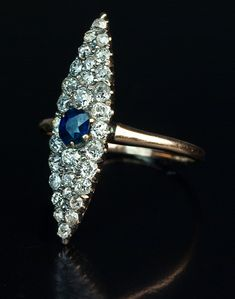 A Vintage Diamond and Sapphire Navette Ring  A 14K rose gold ring is centered with a midnight blue natural sapphire (approximately 0.37 ct)   surrounded by old cut diamonds (estimated total diamond weight 1.25 ct).  The ring is marked with an Imperial Russian assay hallmark for the period 1899-1908.