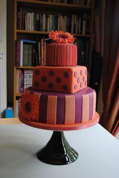 Orange and purple wedding cake by Bath Baby Cakes, via Flickr