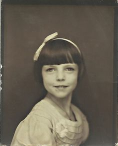 +~ Vintage Photo Booth Picture ~+  Adorable girl with white head band and bow.