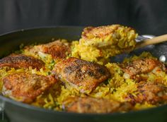 Crispy chicken and saffron rice skillet / 8 bone-in skin-on chicken thighs, about 3 pounds 1 medium onion, chopped medium 3 garlic cloves, diced small 2 cups white rice 4 cups chicken broth 1 gram of saffron 1 cup frozen peas ½ tsp olive oil salt & pepper