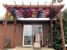 This pergola was built over a week's time as the weather was And so the morning hours were when I put it together, the wrapped it with sheer colored curtains and lights for festivities.