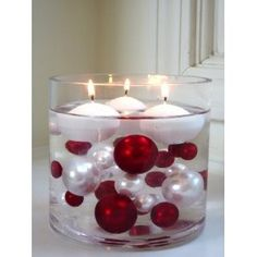 Submerged Ornaments with Floating Candles. I checked the original site, and you need a water gel. Momma suggested a clear gelatin for an affordable route. :)