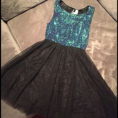 H&M Sequin turquoise and black dress Sequin turquoise and black tulle skirt. Size 6. Tags still on ! H&M Dresses