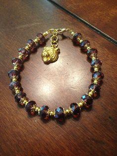 Geaux tigers! Handmade bracelet. Purple and gold Www.facebook.com/BayouBlingLA