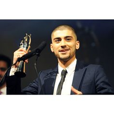 Did Zayn Malik Dye His Hair Green? See the Photo! ❤ liked on Polyvore featuring ppl