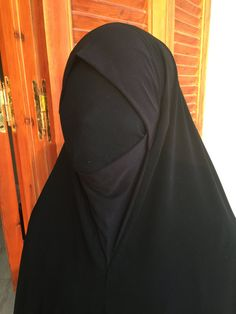 At 61 inches (155 cm) long, our One Piece Fitted Khimaar provides the coverage of a Jilbaab with complete concealment of your arms and hands. The design includes a form fitting material which covers the head, chin and neck area, removing the need for an underpiece. An elastic band, which is to be positioned underneath the Khimaar and pulled over and behind the head, keeps the Khimaar comfortably in place. Satin trim along the entire bottom edge of the Khimaar provides that subtle touch of…