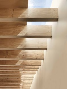 Exposed wood rafters   Sliver of skylight creates a dance of sunlight and shadows   Henry Street House in Australia by Eugene Cheah Architecture Australian Interior Design, Interior Design Awards, Skylight Design, Ceiling Design, Cottage Design, House Design, Modern Skylights, Exposed Rafters, Exposed Wood