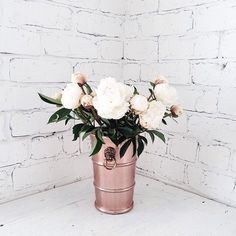 Pin for Later: Simply Beautiful Ways to Display Peonies in Your Home In a Gold Bucket