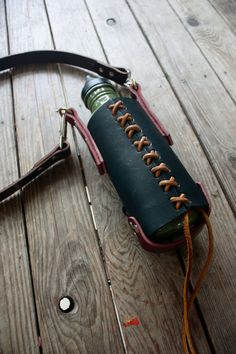 Handmade leather water bottle tote by OneLeashForTheRoad on Etsy, $85.00