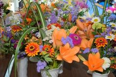 These centerpieces are ready to be placed for a June wedding dinner.