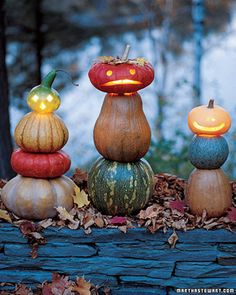 A jack-o'-lantern trying to ward off pranksters from ground level will often come up short. Give him a boost -- and a body -- by setting him atop a stack of pumpkins, squashes, or other winter gourds. Use small wood screws to hold the parts in place.