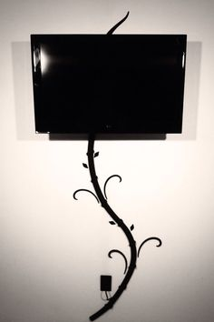 Hide tv and digital picture frame cords without cutting holes in your wall with my creation the Tv-Tree. wall decals to distract Foyer Mural, Tv Escondida, Hide Tv Cords, Hiding Tv Cords On Wall, Hide Wires From Tv, Hide Cables On Wall, Hiding Wires, Deco Tv, Hidden Tv