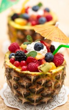 Luau Hawaiian Fruit Salad - For your luau theme party use real fruit as centerpieces using the whole pineapple as your focal point!