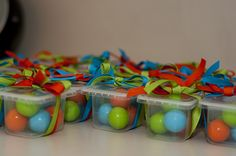 Our favors for the 1st birthday party were gumballs in baby food containers wrapped with the colors of our party!!