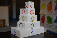 Creative Curriculum Objectives: 46, 28, 29    Create a building block tower with student's name.  Can also do this from left to right.  Allow student to identify letters in name or to identify the blocks from largest to smallest.