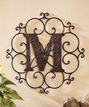"""Monogram Wall Hanging.   $13.95 each.Personalize a wall of your home with this beautiful Monogram Wall Hanging. The classic piece starts with a bold letter embossed in a vining pattern and surrounds it with elegant scrollwork. It makes an impressive statement piece in your home. Bronze-look metal hanging suits any room's decor. Ready to hang. Approx. 19-3/4"""" dia."""