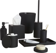 noir side of neat. Tactile stoneware accessories add a modern touch to the bath with a surprising surface of black rubber. Matte exterior contrasts glossy interior, keeping things neat from floor to sink. Stoneware with black rubber coatingGlossy black interiorHand washMade in China.