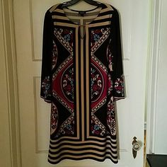 """Beautiful Chic Dress Beautiful Boho Stlye Multi Color Dress. 92% Polyester and 8% Spandex. Approximately 38"""" in Length.  Great Condition.  Size L. This brand is Forever not Forever 21. This is a true size misses dress. Forever Dresses"""