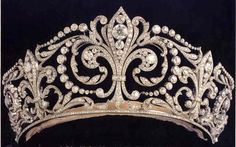 """Made by Ansorena in 1906, the 500+ diamond and platinum tiara features the Fleur de Lys, the heraldic emblem of the House of Bourbon (Borbón). The Fleur de Lys was given by King Alfonso XIII to his bride, Princess Victoria Eugenie of Battenberg (the future Queen Victoria Eugenia """"Ena"""" of Spain), on the occasion of their 1906 wedding."""