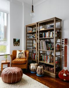 A Bold, Eclectic Home in Chicago's East Loop | Interior Design by Jen Talbot of Jen Talbot Design | Photography by Dustin Halleck | Modern Sanctuary | Bedroom | Bohemian Bedroom | Global Bedroom | Seating | Lighting | Bookshelves