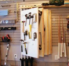 I like this concept - organized, visible, consolidated tool storage. Hubby doesn't like pegboard - use plywood and outline tool shapes so everything goes back where it belongs.
