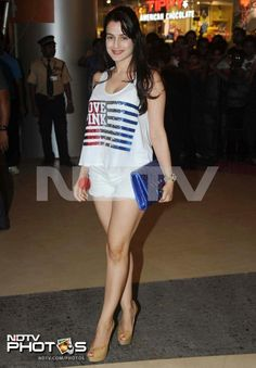 The stars are ready for Dabangg 2, are you? Ameesha Patel shows off her well-toned legs in hot pants and a Victoria's Secret tank top emblazoned with the American flag