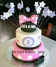 Four tier pink and white pearl fondant Girls 1st birthday cake