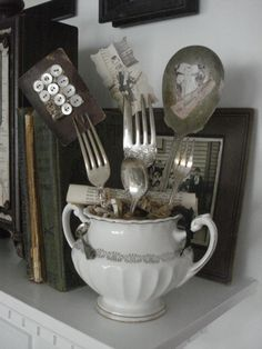 "I have been going to make one of these for my mom with a vtg. cup that says ""Mother"" on it, but I didn't think of using silverware for the photo holders.  That's it...it will be this year's Mother's day gift to my mom with vintage family pictures on it.   Shh, please don't tell her :)"