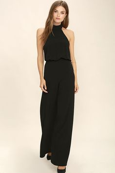 It's time to grab your camera and capture every second in the Moment for Life Black Halter Jumpsuit! This unforgettable woven number features a high mock neck (with back button closures), and a halter bodice with fitted waist. Attached trousers have hidden side seam pockets, and a chic wide-cut. Hidden back zipper.