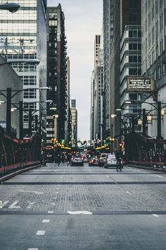 Free download of this photo: https://www.pexels.com/photo/architecture-bridge-buildings-cars-173427/ #city #cars #road
