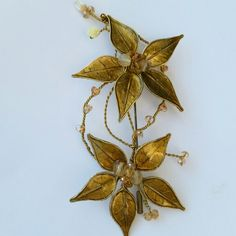 Brooch with natural skeleton leaves, resin and gemstones