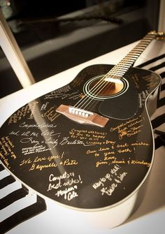 This acoustic guitar is sure to become a family heirloom that your kids might learn to play on. Or maybe its just the perfect reminder of all the love and music in your hearts. Found on Style Grace Events
