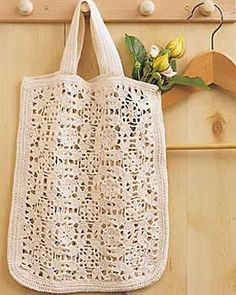 Elegant crochet bag features a beautiful lacy motif. The perfect tote for books, shopping, lunch, and everything else. Approx 10.5 x 13in [26.5 x 33 cm]. Made in Bernat Handicrafter Crochet Cotton on size 1.75 mm (U.S. 2) crochet hook. crochet pattern
