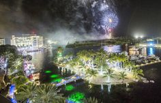 Fireworks light up the sky as gaily decorated boats delight spectators during the annual Parade of Lights at Camana Bay on Saturday night.