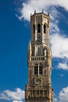 The Belfry (Halletoren) Bruges, is a medieval bell tower in Belgium.  It was built in the market square of Bruges around 1240, but had to be rebuilt in 1280 after a a fire destroyed most of it. The tower has a narrow, steep staircase with  366 steps, which leads to the top of the 83-metre-high building, which actually  leans about a metre to the east.