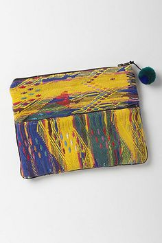 Amparo Foldover Pouch #anthropologie ~ handmade by Mercado Global, a social enterprise that provides business development support to women artisans in Guatemala.