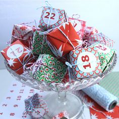 """Such cute little packages in pretty bowl... maybe put candy, small rings, Barbie accessories, Lego's, micro cars, lip gloss, or other small inexpensive 'gifts' to use as a type of advent calendar.  Perfect idea for my son that keeps asking """"is it Christmas yet?"""" and won't eat chocolate."""