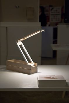 light can be opened to make it brighter or close it to dim it down. compact and sexy by Caroline Olsson