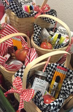 Teacher Appreciation Gifts- I created these picnic themed baskets for our teacher's luncheon. I added a few school supplies, mason jar filled w candy, a few tea bags (calming chamomile and energizing green tea), a bag of almonds and an apple. I think they are adorable!/MBC