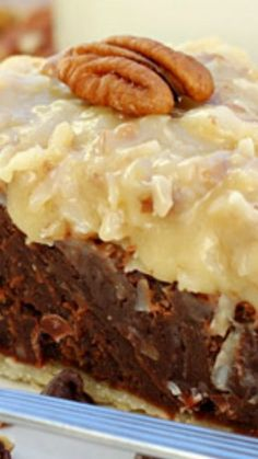 German Chocolate Fudge Pie ~ Decadent and delicious... Rich, fudge-like pie, topped with classic homemade coconut pecan frosting. The chocolate filling is loaded with semi-sweet chocolate chips and pecans, and tastes a lot like a dense, chewy brownie