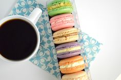 A delicious pairing! Specialty-grade organic coffee with French Macarons. Dessert is served.