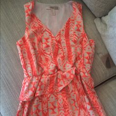 "F21 Summer Dress Coral and beige summer dress. Top is a crossover and has a snap so that it doesn't open. It's peplum style around waist with a side tie. Length approx 34"" and waist 14"". Waistline is elastic so has a give. Double lined. Forever 21 Dresses"