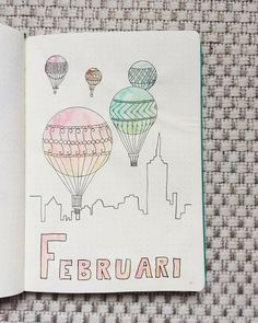 Bullet journal monthly cover page, February cover page, hot air balloon drawing. | @emyplanner