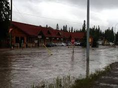 """Flood waters in Bragg Creek have forced more than people from their homes, after a mandatory evacuation order was called early Friday morning.""""It's absolute devastation. We've never had water he. Bragg Creek, Long A, Nature Images, Global Warming, Calgary, Climate Change, Sustainability, Planets, Environment"""