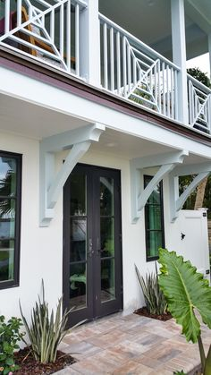 LOVE THE CORBELS, CUSTOM RAIL, FRENCH DOORS & SIDE WINDOWS WITH GREAT CONTRASTING COLOR.